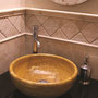 Ivory travertine wall tiles and pencil liners. Giallo travertine carved sink.