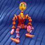 DECO-PERS-MOD-001-Femme orange H.15cm (modelé et peint à la main) - 60€