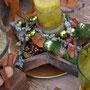 Holzstern mit grüner Kerze