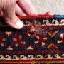 Tabriz carpet Udine, riparazione tappeto tarmato, tappeto gashgay Persiano antico 800, cliente mi ha portato che aggredite da tarme con tanti problemi da foto si vede un buco con trama e ordito molto debole da cambiare.