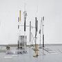 Nomaden, 2018,  Raumzeichnung mit Zeltstangen, Metallrohren, Tape, Gummi, Glas, Accoustic Mousse, C-Prints