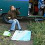 pistek'sche art der reiseplanung: flasche wein und strassenkarte