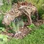 Ein Dinosaurier im Garten