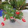 """A. Mühlbauer: Anthurien, Monstera-Blätter, gefärbte Bambusstäbe - """"Besuch aus dem Glashaus"""""""