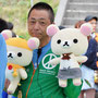The leader of the Peace Project with Rirakkuma in hand