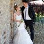 Aufwendiges Brautkleid aus gefälteltem Seidenorganza mit eingearbeiteter Korsage und abnehmbaren Rock aus Seidenorganza & Spitze