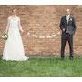 Elegantes Brautkleid aus Seidentaft und weichem Pünktchentüll mit Reifrock