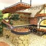 Фото барбекю комплекса под навесом: казан, мангал, каминная вставка, вертел, коптильня