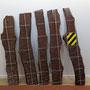 Sans titre,  images photographiques marouflées sur planches de bois, films adhésifs,  150x180x30cm, 2012