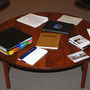 Reading table with curator's research binder and objects, 2011-2012.