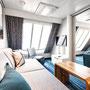 Familienkabine Außen Wohnbereich/ Schlafbereich 3 | © TUI Cruises