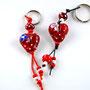 VERKAUFT! Rot mit weissen Pünktli und blauer resp. rosa Blüte; Herz je ca. 2 cm breit; HERZ LINKS VERKAUFT