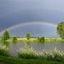 Regenbogen über dem Erlensee