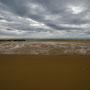 Gezeitenmuster im Sand