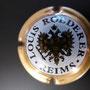 Marque : ROEDERER Louis N° Lambert : 95a - type 6 Couleur : Contour Or, verso Or Description : Blason aigle à 2 têtes, tenant   dans ses serres 1 sceptre et un globe,   écusson central contenant un chevalier en   armure.  Emplacement : 094-06-02