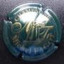 Marque : FAGOT Michel N° Lambert : 16 Couleur : Vert et or Description : Nom du producteur et initiales stylisées  Emplacement :