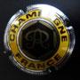 Marque :  ROTHSCHILD N° Lambert : 5 Couleur :  Or, jaune et acier. Striée Description : Lettre R cursive dans un hexagone.   Emplacement : 094-08-02