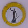Marque : HANON Régis N° Lambert : 1.2 Couleur : Contour jaune Description : Statuette - nom de la marque Emplacement :