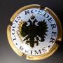 Marque : ROEDERER Louis N° Lambert : 95 - type 1 Couleur :  Contour Or Description : Blason aigle à 2 têtes, tenant   dans ses serres 1 sceptre et un globe,   écusson central contenant un chevalier en   armure.  Emplacement : 094-05-04