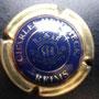 Marque : HEIDSIECK Charles N° Lambert : 59 Couleur : Centre bleu Description : Initiales dans armoiries  Emplacement :