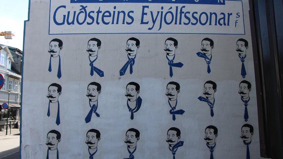 Wand mit gemalter Werbung für Kravattenladen in Reykjavík. Bild von Dani Joh auf Pixabay.