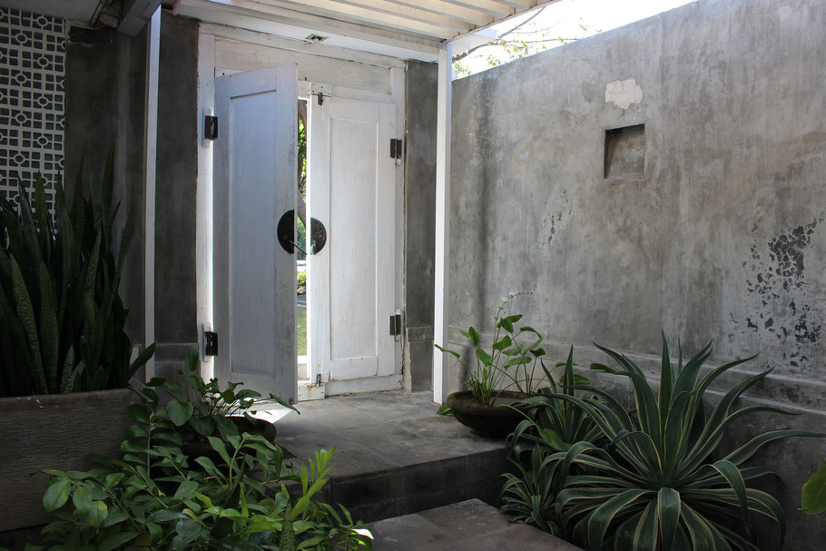 On arrival at the villa,  you will enter a white wooden gate.