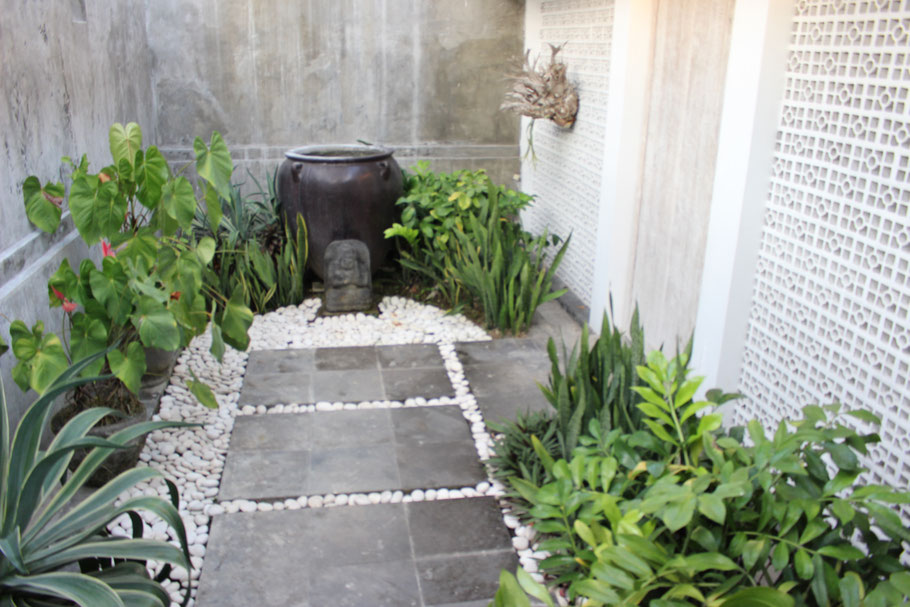 Then you will be welcomed to a small landscaped garden.