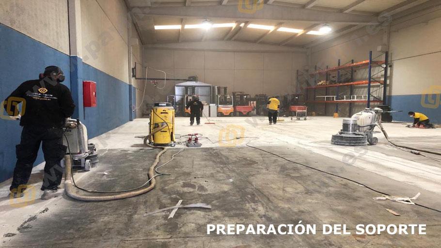 Preparación del soporte antes de la aplicación del suelo de resinas para naves de producción