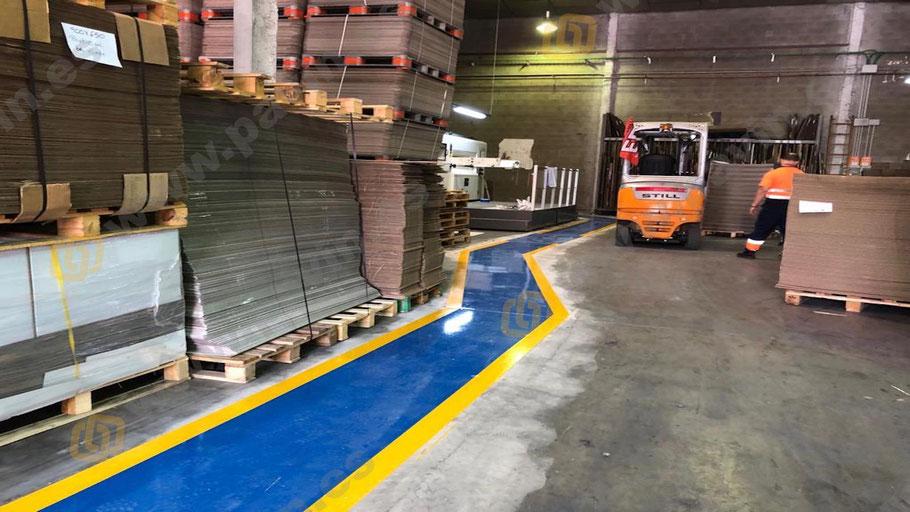 Suelos de resina para pavimentos industriales en el sector de las artes gráficas aplicados por Grupo Pavin pasillos peatón