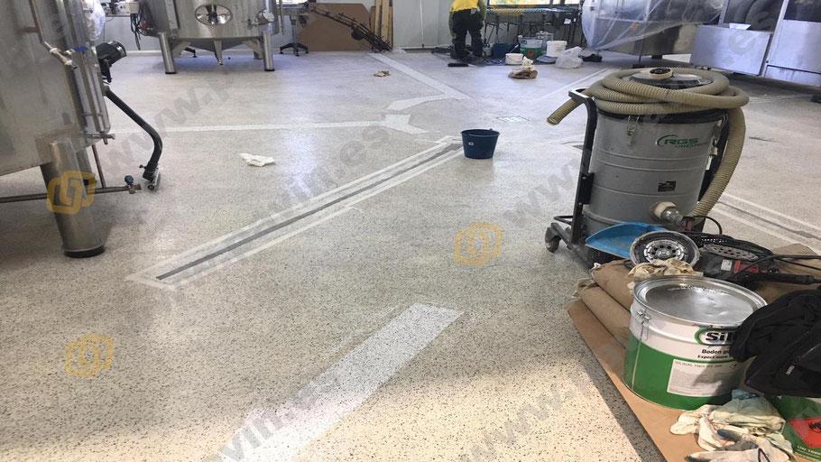 Parcheo con resinas de secado rápido para el pavimento continuo de una empresa vinícola realizado por Grupo Pavin