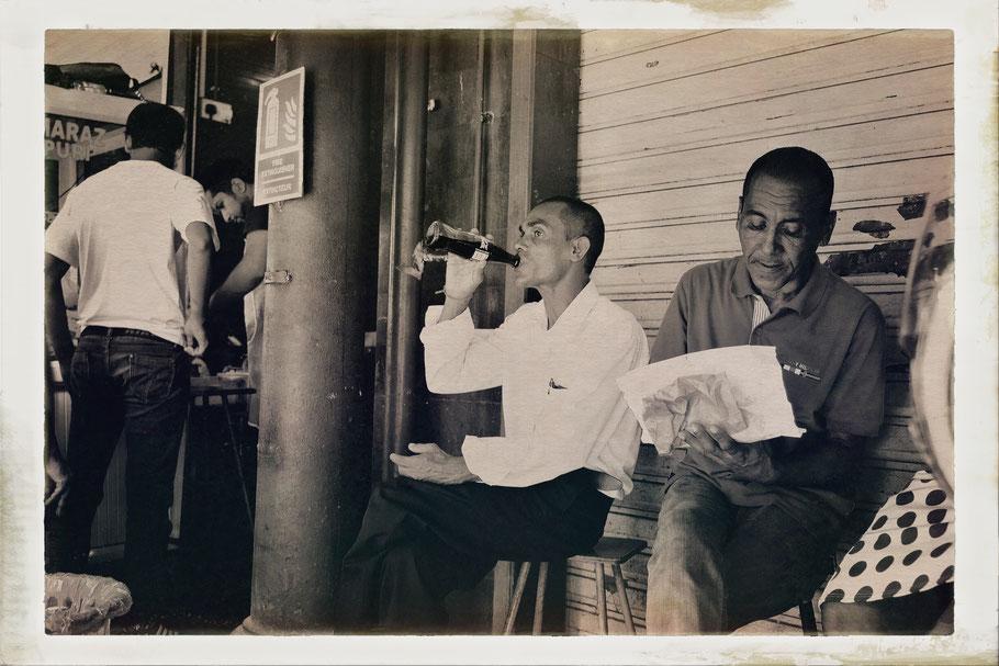 Mauritius man drinking coke