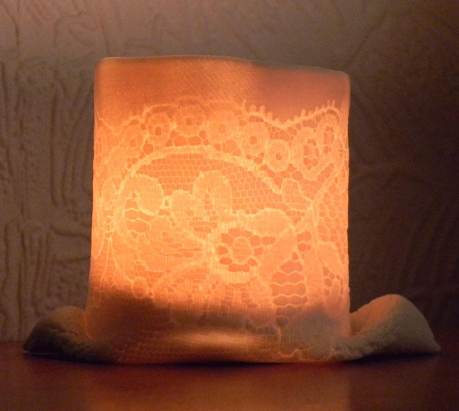 porcelain tea light holders with fine lace imprint detail