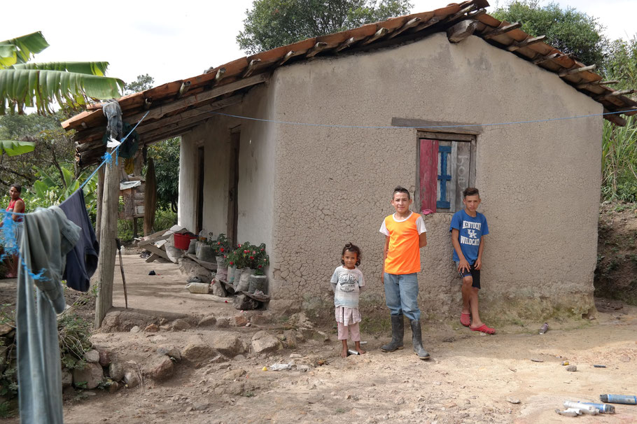 Sael and his siblings in front of their house