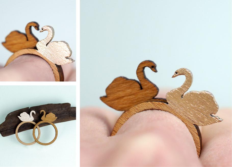 Schwanenpaar; - zwei Schwanenringe, die als Paar getragen zusammen ein Herz bilden