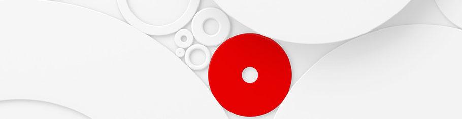Ein rotes Rädchen innerhalb mehrerer weißer. Bereits das Drehen einer Stellschraube bewirkt etwas auch an anderen Stellen.