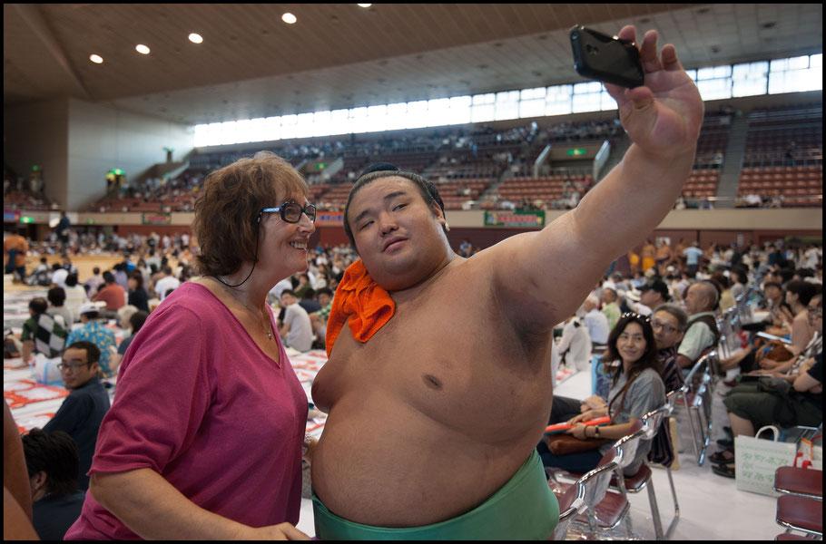 Takakeisho with a fan at a regional tour event in Sendai - John Gunning, Inside Sport: Japan, Aug 13, 2016