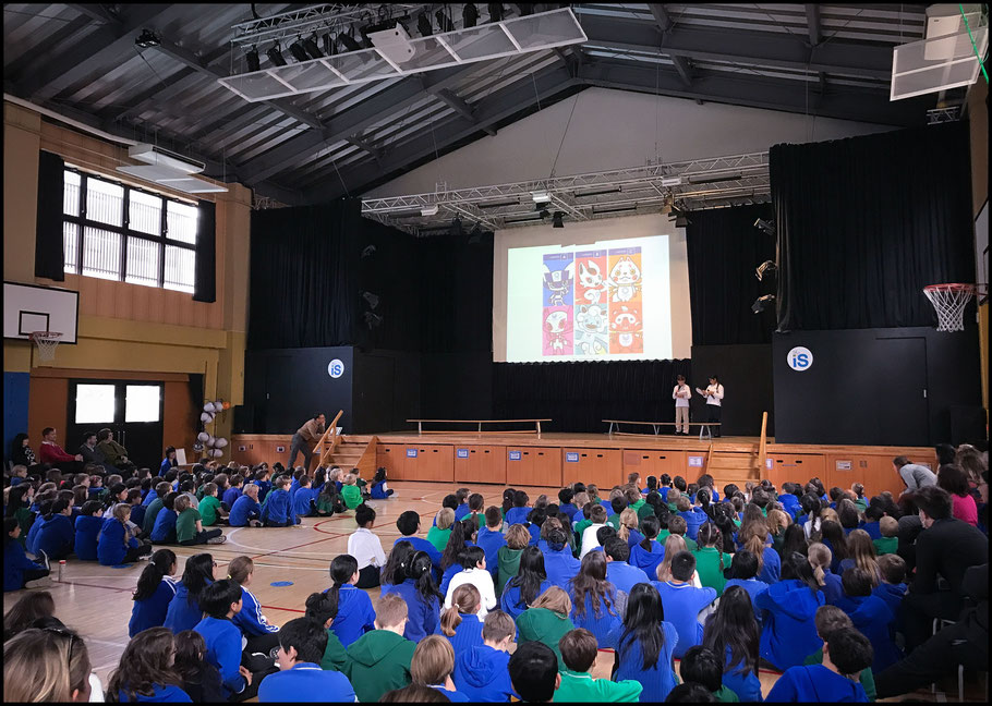Children at TIS watch a presentation about Olympic mascots – John Gunning, Inside Sport: Japan, Jan 30th, 2018