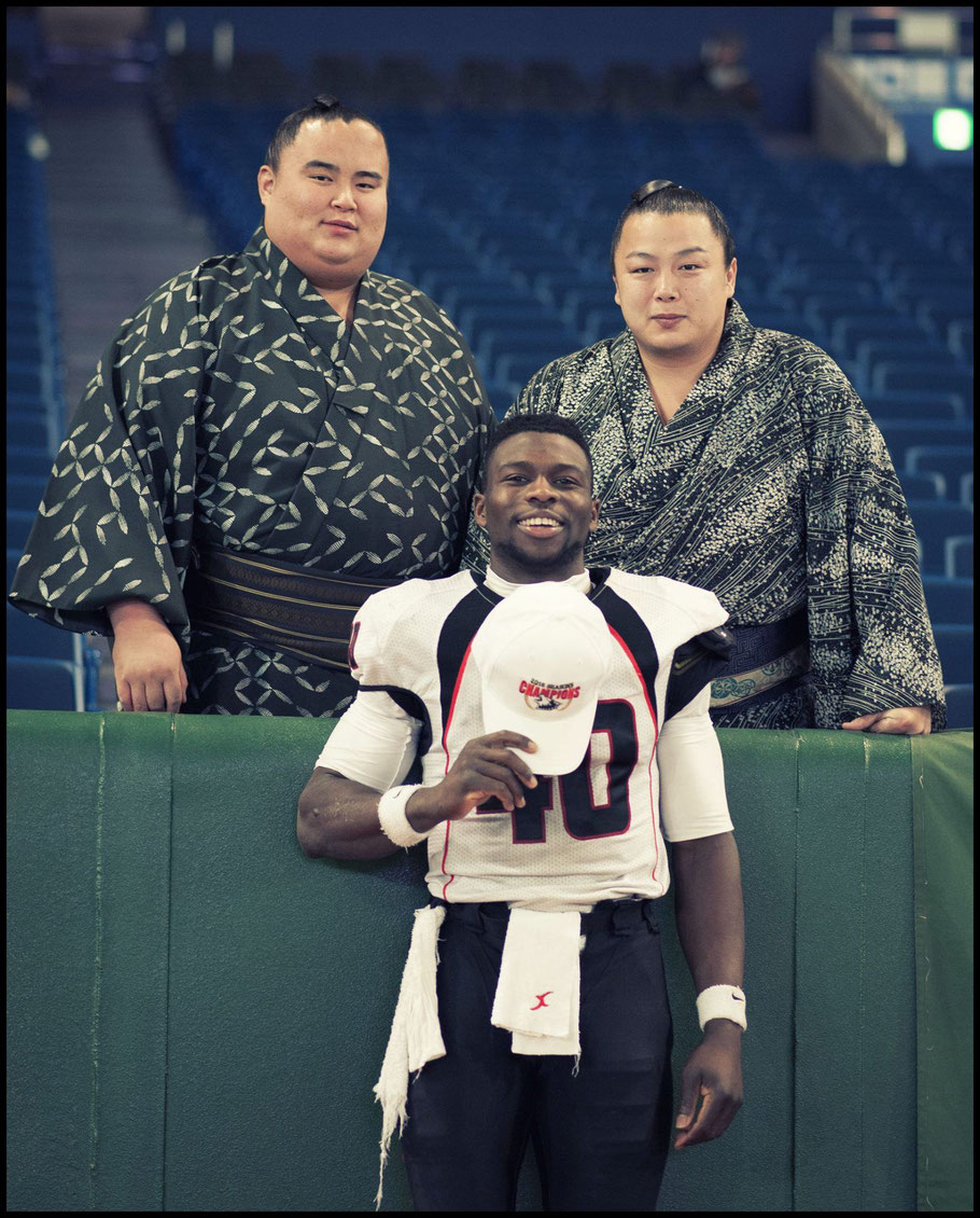 Fujitsu DB Al Rilwan Adeyemi with rikishi after 2017's Rice Bowl – John Gunning, Inside Sport: Japan, Jan 3rd, 2017