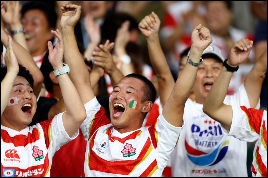 Japanese fans celebrate a famous victory - Clive Rose (World Rugby via Getty)