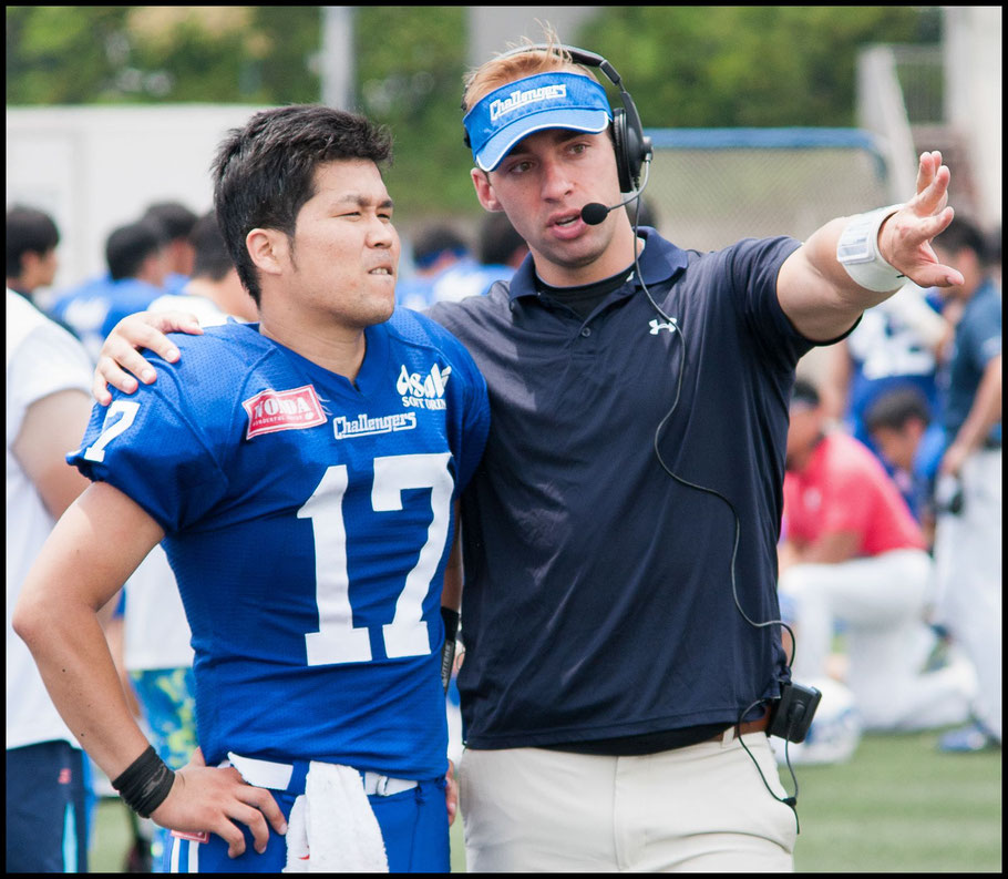 Challengers QB / Coach Alex Niznak giving advice to to QB Yusaku Miyagi — Lionel Piguet, Inside Sport: Japan, May 21, 2017