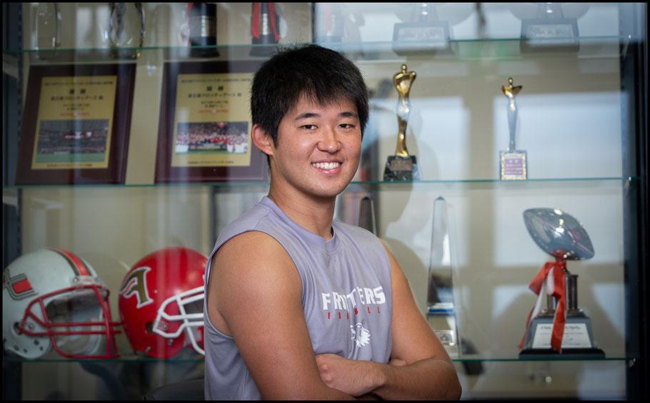 Tsubasa Tagaki in front of Frontiers' trophy cabinet — John Gunning, Inside Sport: Japan, Dec 8, 2019