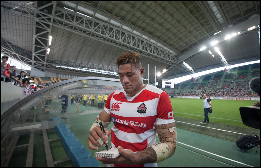 Amanaki Mafi signs autographs with the closed roof visible behind him - Lionel Piguet, Inside Sport: Japan, June 16th, 2018