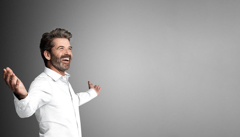 happy man in white shirt with open arms