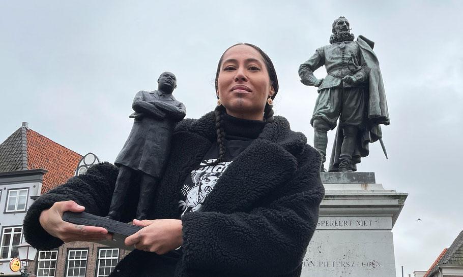 In front of the JP Coen statue in the city of Hoorn