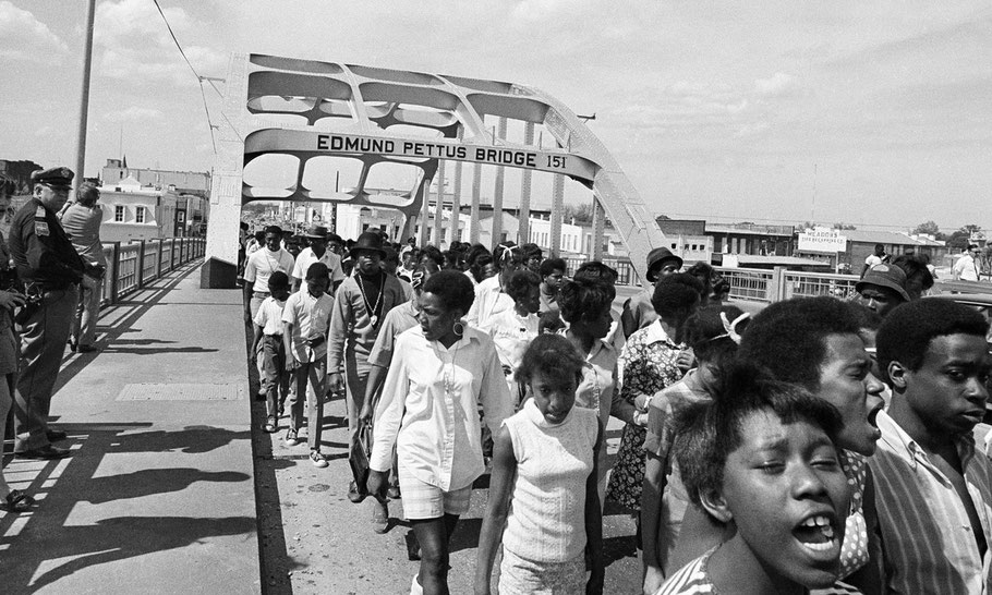 Dr. Martin Luther King, Jr. led marchers across the Edmund Pettus Bridge in Selma on March 21, 1965. - New York Times