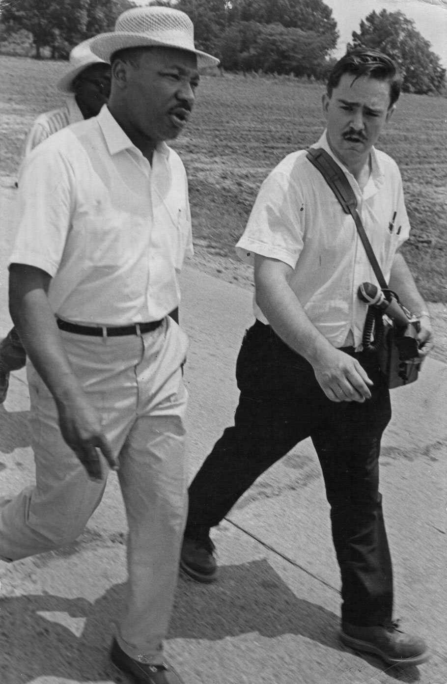 Dr. King and Harky, carrying his tape recorder, 1966