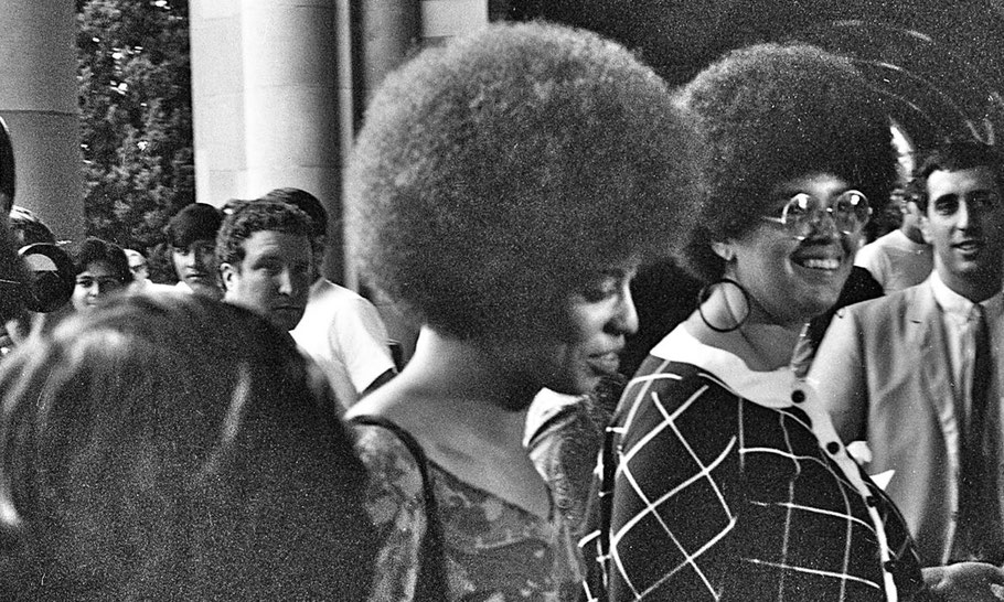 Angela Davis enters Royce Hall for her first lecture, October 7, 1969
