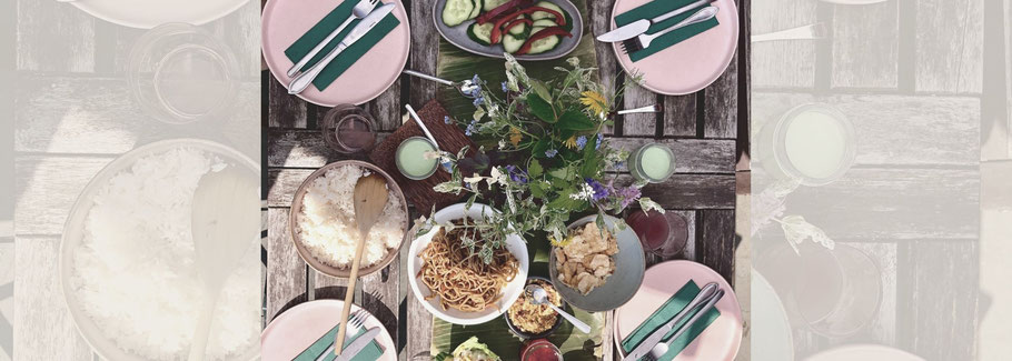 Set table with Indonesian food.