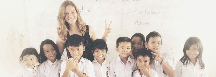 Corinna with school kids in Indonesia