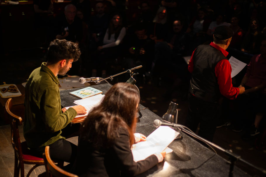 Martin Jankowski, Tomás Cohen, Pegah Ahmadi reading a poem in Spanish, English, and German at the same time